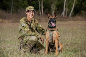 Australian Army Private Beata Wawrzynowicz and Military Police Dog Azura from the 1st Military Police Battalion. Photo by Leading Aircraftwoman Emma Schwenke.