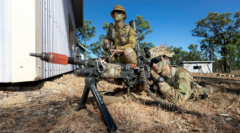 An Australian Army soldier from Battlegroup Coral and a United States Army paratrooper provide security during clearance of an enemy position. Story by Captain Diana Jennings. Photo by Corporal Brandon Grey.