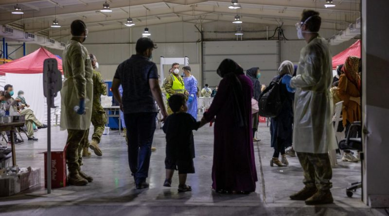 Evacuees enter the evacuee handling centre at Australia's main operating base in the Middle East, following their evacuation from Kabul, Afghanistan. (This image has been digitally manipulated). Story by Lieutenant Max Logan. Photo by Leading Aircraftwoman Jacqueline Forrester.