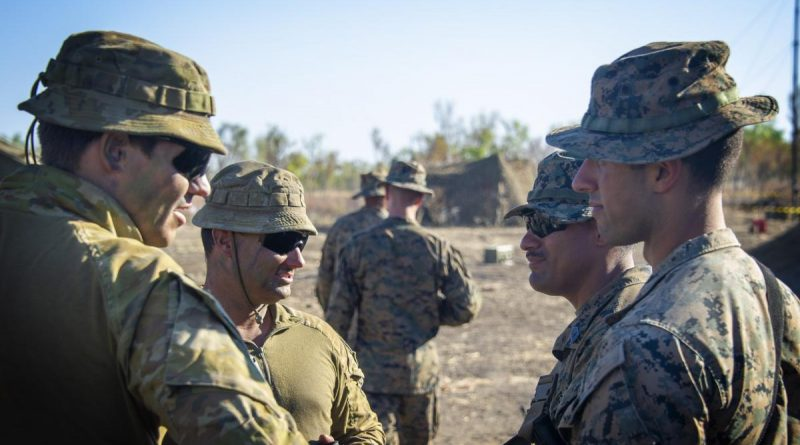 Australian soldiers from 1st Combat Signal Regiment discuss upcoming training with marines at Bradshaw Field Training Area during Exercise Koolendong. Story and photo by Captain Carla Armenti.