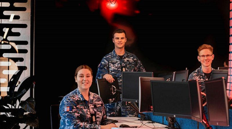 Air Force Officer Cadets Josephine Curtis, left, William Farrell and Elliot Parker, from the Australian Defence Force Academy, are training to become cyber security officers. Story by Flying Officer Lily Lancaster. Photo by Leading Aircraftman Adam Abela.