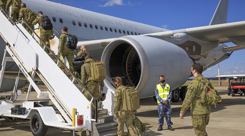 A contingent of Royal Australian Air Force and Australian Army personnel board a KC-30A multi-role tanker transport at RAAF Base Amberley bound for the Middle East to support evacuation efforts from Afghanistan. Photo by Corporal Brett Sherriff.