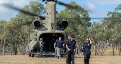 Australian Institute of Sport representatives exit a CH-47 Chinook at the Townsville Field Training Area during a visit to the Command Training Centre in Townsville, Queensland. Story by Paulina Acuna. Photo by Corporal Sagi Biderm.