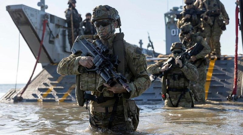 Personnel from the 3rd Battalion Royal Australian Regiment, conduct a beach assault on Forrest Beach, Queensland, during Exercise Talisman Sabre 2021. Story by Private Jacob Joseph. Photo by Leading Aircraftwoman Jacqueline Forrester.