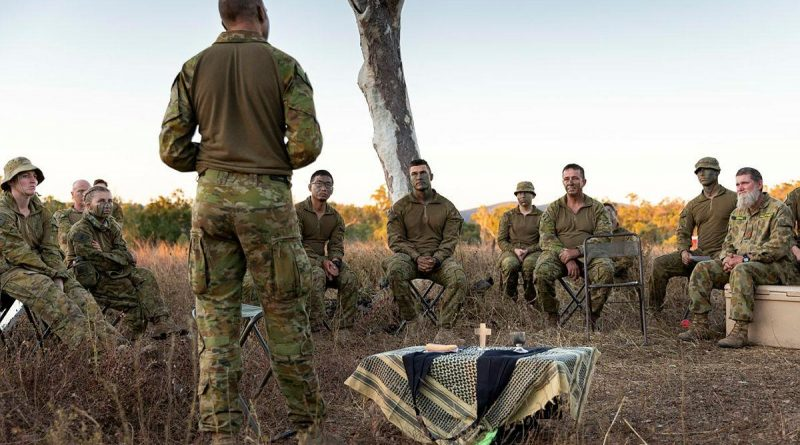 Chaplain Gary Pope, of the 3rd Brigade Headquarters, delivers a field service to soldiers during Exercise Talisman Sabre at Townsville Field Training Area, Queensland. Story by Captain Diana Jennings. Photo by Corporal Brendon Grey.