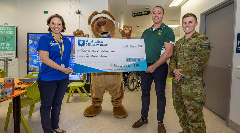 Soldiers from 3RAR donate a cheque for $10,000 to the children's ward at Townsville University Hospital. Story by Captain Lily Charles. Photo by Corporal Brandon Grey.