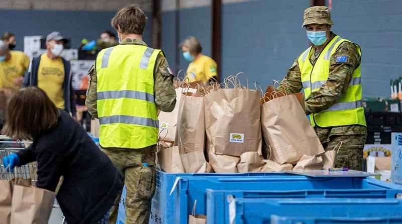 Army personnel and OzHarvest volunteers prepare dry and fresh food hampers in the OzHarvest warehouse at Alexandria, Sydney, a part of Operation COVID-19 Assist. Story by Captain Martin Hadley. Photo by Corporal Dustin Anderson.