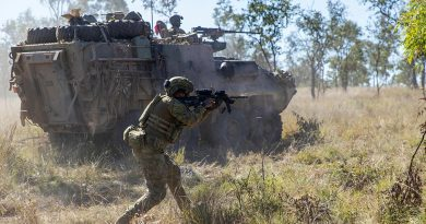 Private Harry Price from the 1st Battalion, Royal Australian Regiment, and mounted soldiers from the 2nd Cavalry Regiment engage an enemy position during Exercise Eagle Run at the Townsville Field Training Area. Story by Captain Lily Charles. Photo by Corporal Brodie Cross.