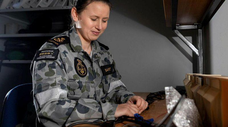 Petty Officer Electronics Technician Emma Barnett conducts work at HMAS Albatross in Nowra. Story by Sub Lieutenant Nancy Cotton. Photo by Leading Seaman Ryan Tascas.