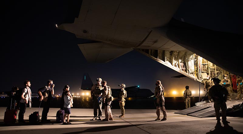 Evacuees board the first Australian rescue flight out of Kabul, Afghanistan. Photo by Sergeant Glen McCarthy.