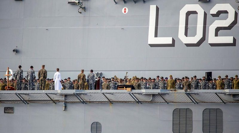 The ship's company of HMAS Canberra commemorates the 79th anniversary of the Battle of Savo Island on the flight deck while at sea in the Western Pacific. Story by Lieutenant Sarah Rohweder. Photo by Leading Seaman Ernesto Sanchez.