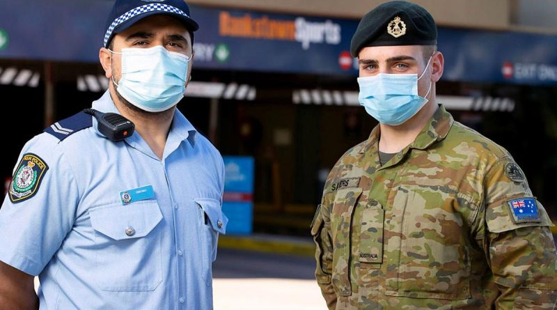 NSW Police and Private Jordan Sayers work together to patrol the Bankstown sports centre in support of the NSW Operation Covid-19 Assist. Story by Lieutenant Commander John Thompson. Photo by Corporal Dustin Anderson.