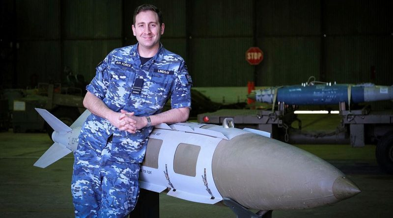Defence Explosive Ordnance Training School instructor Flight Lieutenant Ben Lindsay with a teaching aid, a 2000-pound joint direct attack munition. Story by Flight Lieutenant Julia Ravell.