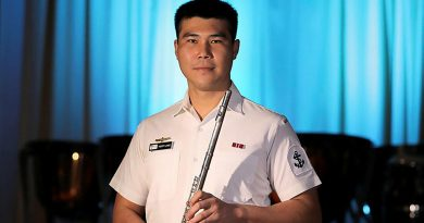 Leading Seaman Henry Liang with his flute. Story by Leading Seaman Jonathan Rendell. Photo by Petty Officer Nina Fogliani.