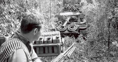 Private Frank Jelen of 3RAR sitting on an armoured recovery vehicle during Operation Overlord on the border of Phuoc Tuy and Long Khanh Provinces, June 1971.