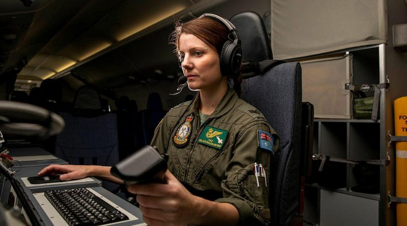 Sergeant Taryn Allen from No. 11 Squadron on board a P-8A Poseidon during Exercise Talisman Sabre 2021. Story by Flight Lieutenant Chloe Stevenson. Photo by Leading Aircraftwoman Emma Schwenke.