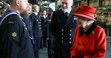 Leading Seaman Matt Jones, left, meets Her Majesty the Queen on board the Royal Navy's flagship carrier, HMS Queen Elizabeth, as she farewells Carrier Strike Group 21 ahead of its Indo-Pacific deployment. Story by Lieutenant John Paul. Photo by Petty Officer Jay Allen.