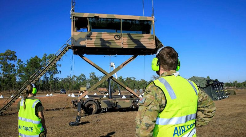Leading Aircraftwoman Rebecca Hay and Corporal Thomas Geraghty raise the transportable air operations tower at RAAF Base Scherger. Story by Flight Lieutenant Nick O'Connor. Photo by Corporal Brett Sherriff.