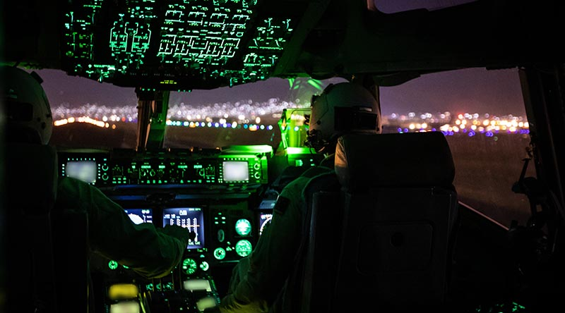 Royal Australian Air Force C-17A Globemaster pilots Flight Lieutenants Sam Stephens and Stephen Vanderdoes prepare to take off from Hamid Karzai International Airport after boarding Australian citizens and visa holders to evacuate from Afghanistan. Photo by Sergeant Glen McCarthy.