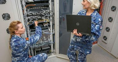 Aircraftwoman Lauren Campbell, left, with Corporal Natalie Ekonomopoulos in a communications cabinet for cyber research and development systems at No. 462 Squadron. Story by Flight Lieutenant Georgina MacDonald. Photo by Corporal Brenton Kwaterski.