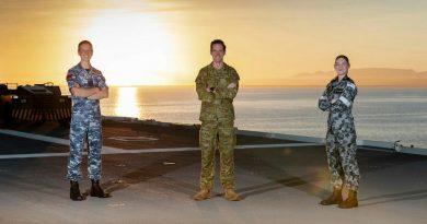 Army Captain Samuel O'Neal, centre, RAAF Flying Officer Kristian Henderson and RAN Leading Seaman Medic Erika Birkefeld on board HMAS Canberra during Exercise Talisman Sabre 2021. Photo by Leading Seaman Sittichai Sakonpoonpol.
