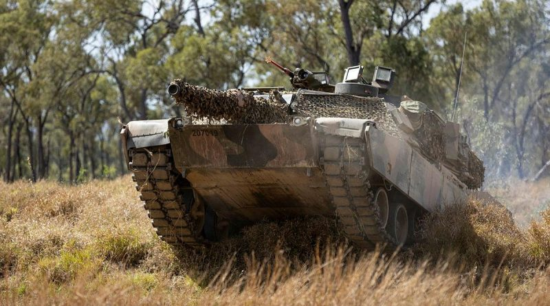 An Australian Army M1A1 Abrams tank from the 2nd Cavalry Regiment moves forward in a simulated attack serial held at the Townsville Field Training Area as part of Exercise Talisman Sabre. Story by Warrant Officer Class 2 Max Bree. Photo by Corporal Brandon Grey.