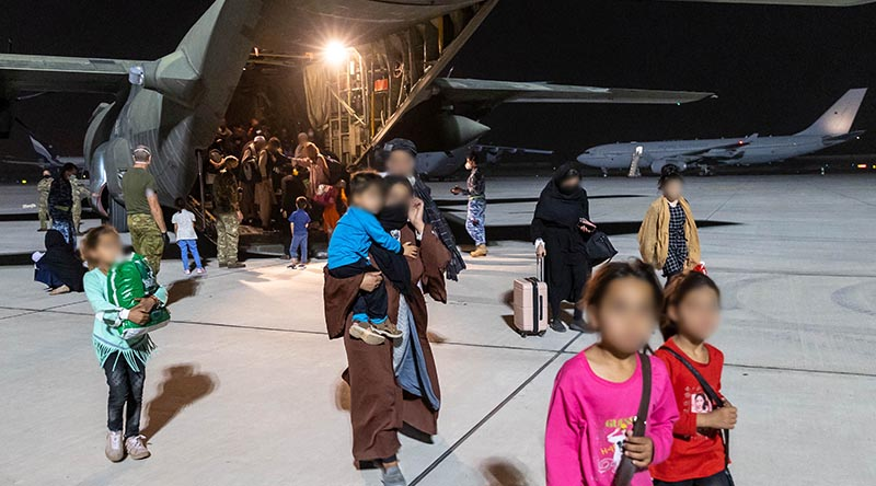 Evacuees from Afghanistan disembark a Royal Air Force C-130 Hercules at Australia's main operating base in the Middle East. Leading Aircraftwoman Jacqueline Forrester.