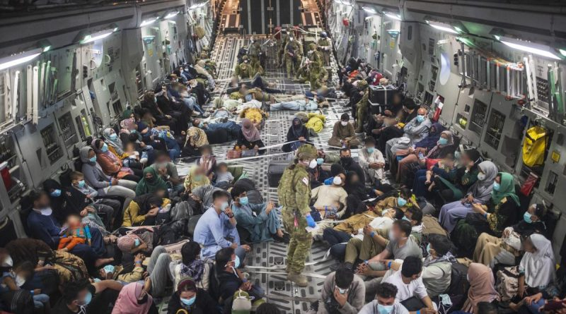 Australian citizens and visa holders evacuated from Afghanistan on board a RAAF C-17A Globemaster III, enroute to the ADF's main operating base in the Middle East region. Story by Lieutenant Commander Andrew Ragless. Photo by Sergeant Glen McCarthy.