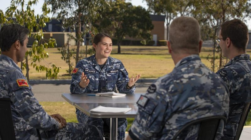 Flying Officer Maddison Brassil shares experiences with colleagues at RAAF Base Amberley, as part of the mentoring program. Story by Erin Fomin. Photo by Corporal Jesse Kane.