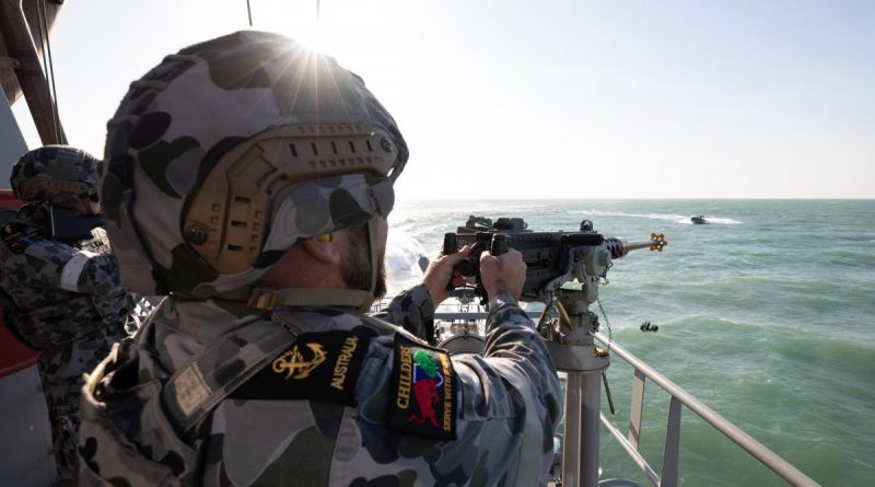 Leading Seaman Boatswains Mate Thomas Kelly engages a 'hostile' craft with a 12.7mm heavy machine gun aboard HMAS Childers during a defensive training activity. Story by Lieutenant Gordon Carr-Gregg. Photo by Petty Officer Peter Thompson.