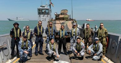 Embarked foreign personnel for Indo-Pacific Endeavour 21 stand on-board a Light Landing Craft from HMAS Canberra off the Port of Darwin before departing for Exercise Indo-Pacific Endeavour 21. Story by Captain Peter March. Photo by Leading Seaman Sittichai Sakonpoonpol.