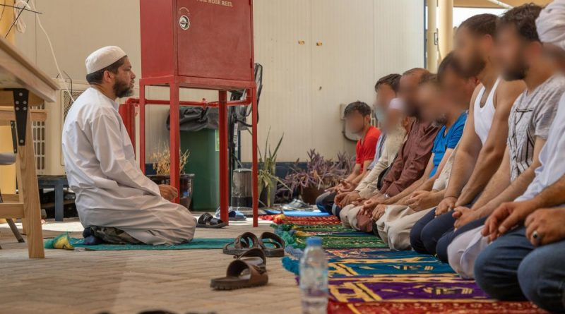 Islamic Imam, Royal Australian Navy Chaplain Majidih Essa, conducts Friday prayers for Muslim Afghanistan evacuees at the ADF's main operating base in the Middle East. Story by Lieutenant Max Logan. Photo by Leading Aircraftwoman Jacqueline Forrester.