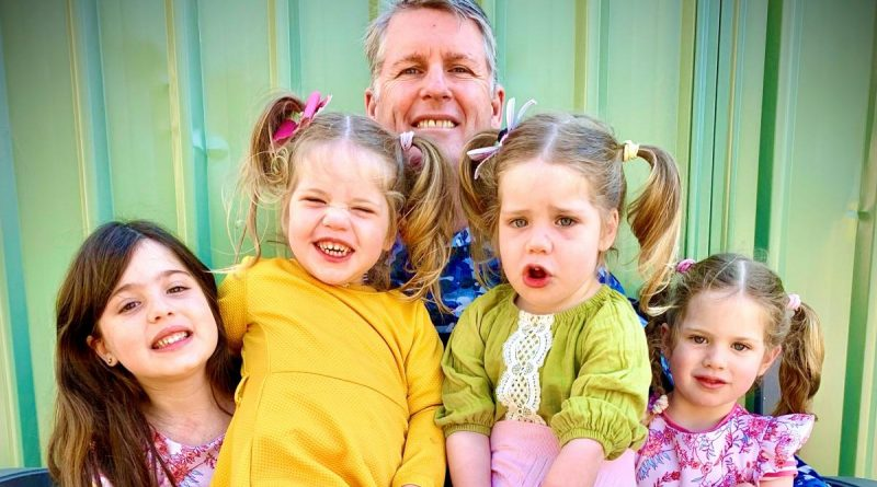 Flight Lieutenant Neil Young with his daughters, from left, Alexa, 6, twins Ella and Sophia, 2, and Ariana, 4. Story by Bettina Mears.