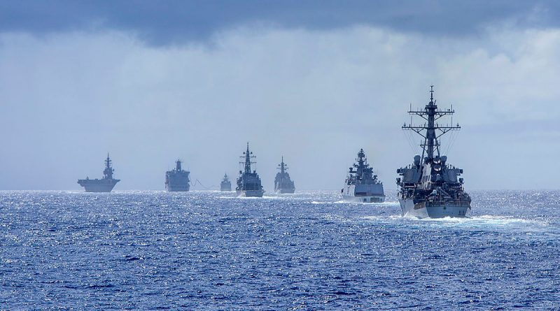Warships from the Japan Maritime Self-Defense Force, Indian Navy and United States Navy take formation during Exercise MALABAR 2021. Story by Lieutenant Geoff Long. Photo by Petty Officer Yuri Ramsey.