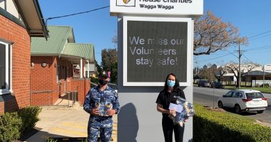 Aircraftman Antonio Keedle-Gradenza presents the donations to Lisa Simpson in Wagga Wagga. Story by Flying Officer Brent Moloney.