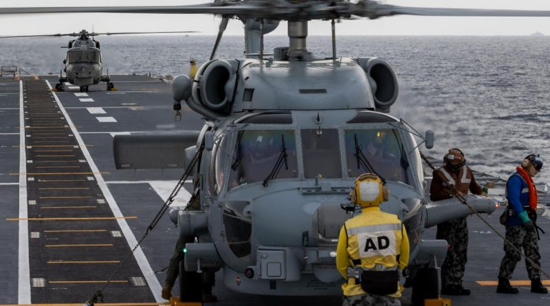 Royal Malaysian Navy Super Lynx and RAN MH-60R helicopters perform deck landing exercises on board HMAS Canberra as part of the Malaysia-Australia Training Exercise. Story by Captain Peter March. Photo by Petty Officer Christopher Szumlanski.