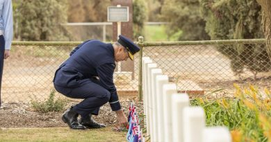 Air Commodore Ross Bender lays a sprig of rosemary at one of the grave sites during a commemoration ceremony at Mallala War Cemetery. Story by Group Captain Greg Weller. Photo by Leading Aircraftman Stewart Gould.