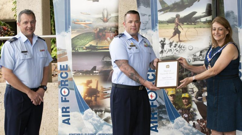 Senior ADF officer at RAAF Base Townsville Wing Commander Mathew Green watches on as Sergeant Tory Tipler is presented with his award by Townsville Mayor Jenny Hill. Story by Flying Officer Robert Hodgson.