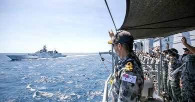 HMAS Warramunga's Commanding Officer, Commander Stewart Muller, and the Ship's Company wave farewell, as Indian Navy Ships Shivalik and Kadmaat sail past at the conclusion of AUSINDEX 2021. Story by Lieutenant Geoff Long. Photo by Petty Officer Yuri Ramsey.