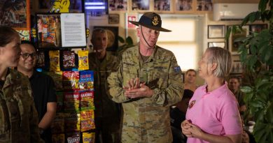 Commander Joint Task Force 633 Air Commodore David Paddison celebrates the 10th anniversary of the 'Bean around the MEAO' café with owner Aileen Stoddart. Story by Flight Lieutenant Clarice Hurren. Photo by Sergeant Glen McCarthy.