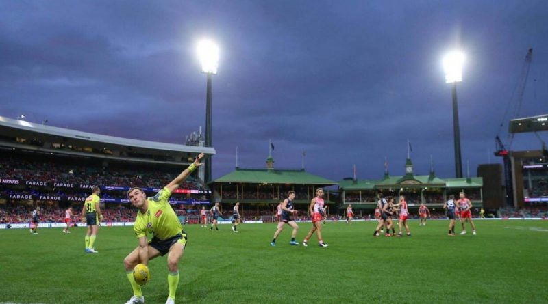 ADF Aussie Rules Association's Sergeant David Wood umpires an AFL match at the SCG during the 2021 Toyota AFL Sir Doug Nicholls Round. Story by Lieutenant Ben Willee.