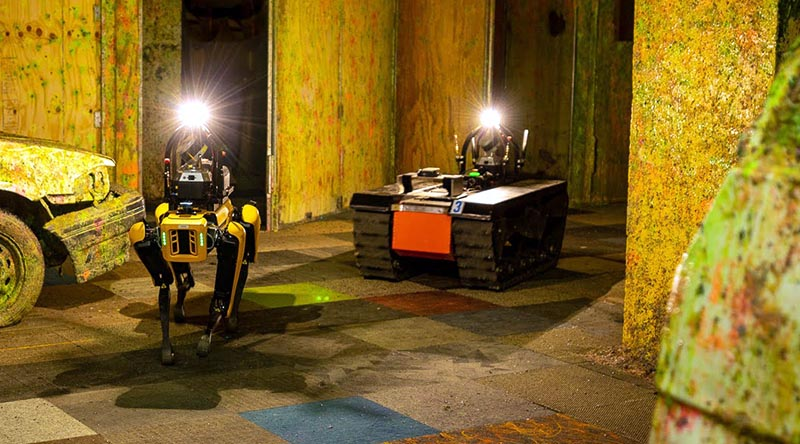 One of Team CSIRO DATA61 quadruped robots with a tracked all-terrain robot in a simulated underground-emergency environment. Photo supplied.