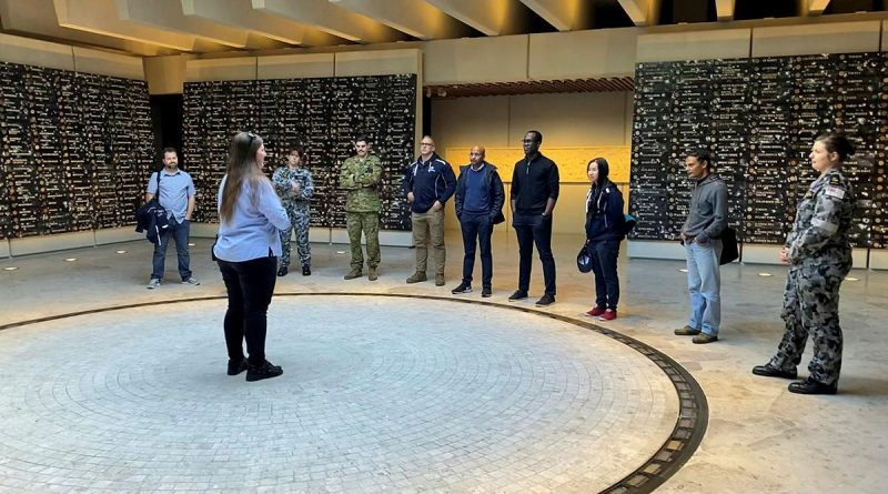 Ashleigh Taylor, from the Anzac Memorial, guides ADF Cyber Gap Program participants around the memorial in Sydney's Hyde Park.