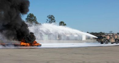 Air Force's No. 23 Squadron Aviation Rescue and Fire Fighting personnel apply fluorine-free foam to extinguish a large demonstration aviation fuel blaze. Story by Flying Officer Robert Hodgson. Photo by Sergeant Andrew Eddie.