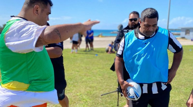 Tongan participants Vaopako Pongi, left, and Lolomanoia Tuifua enjoy a practical session for rugby league coaches, including game-day drills. Story by Alex DeValentin.