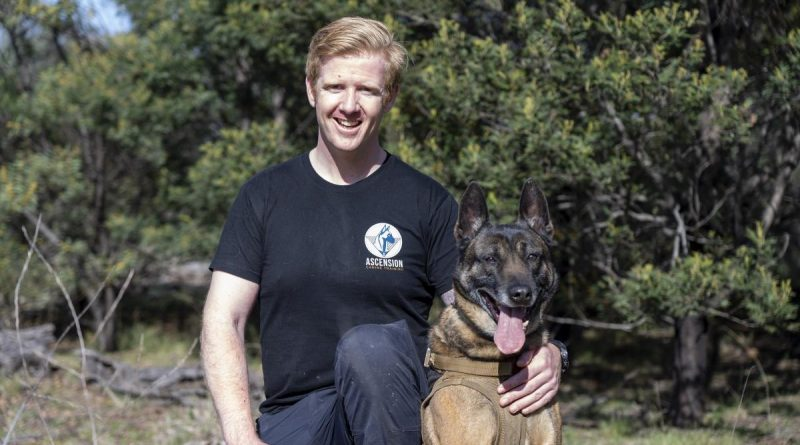 Corporal Jeremy Wikner with his Belgian malinois, Charlie.