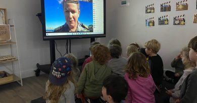 Executive Officer HMAS Watson Commander Tina Brown talks to children from 15 Active Kids Group childcare centres via Zoom during Kids Safety Week. Photo by Emma Wholihan, Active Kids Group