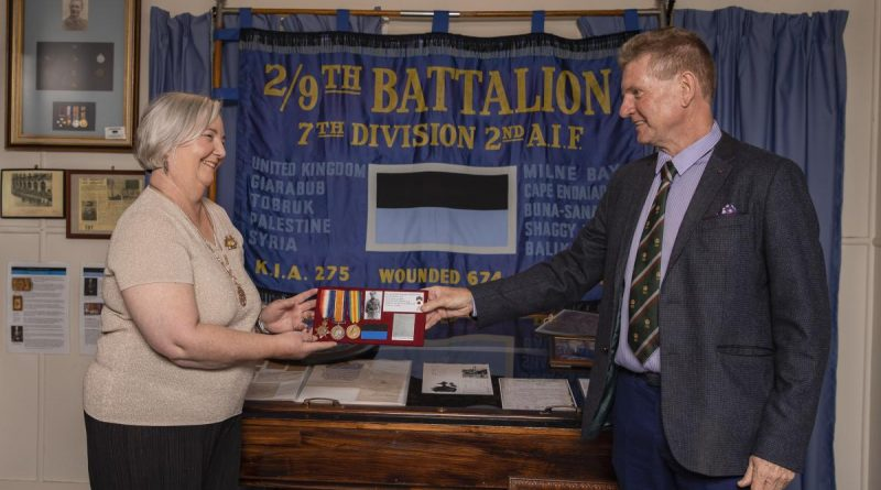 Len Kelly returns the medals of World war I veteran Lieutenant Norman Weynand to his family member Lynne Bennett at the 9th Battalion Museum at Gallipoli Barracks Brisbane. Story by Corporal Olivia Cameron.