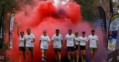 Australian and American ultramarathon runners celebrate the completion of the 1000 Miles to Light run held around Singleton Military Area, NSW. Story by Lieutenant Sasha Rhodes.