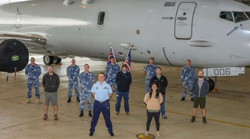 Officer Commanding No. 92 Wing, Group Captain John Grime, front centre, stands with staff and personnel from Surveillance and Response Systems Program Office, No. 92 Wing and Boeing in front of P-8A Poseidon A47-006. Story by Bettina Mears. Photo by Corporal Brenton Kwaterski.
